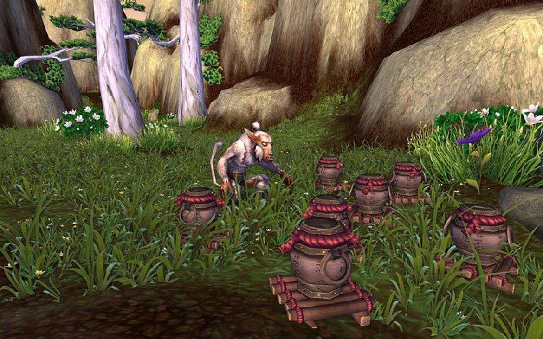 Mists of Pandaria -- Monkey checking out some Pandaren pots