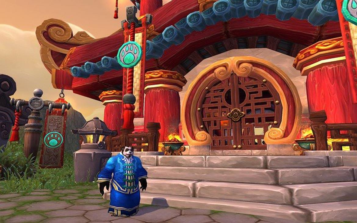 Mists of Pandaria -- Pandaren in front of a Pandaren building