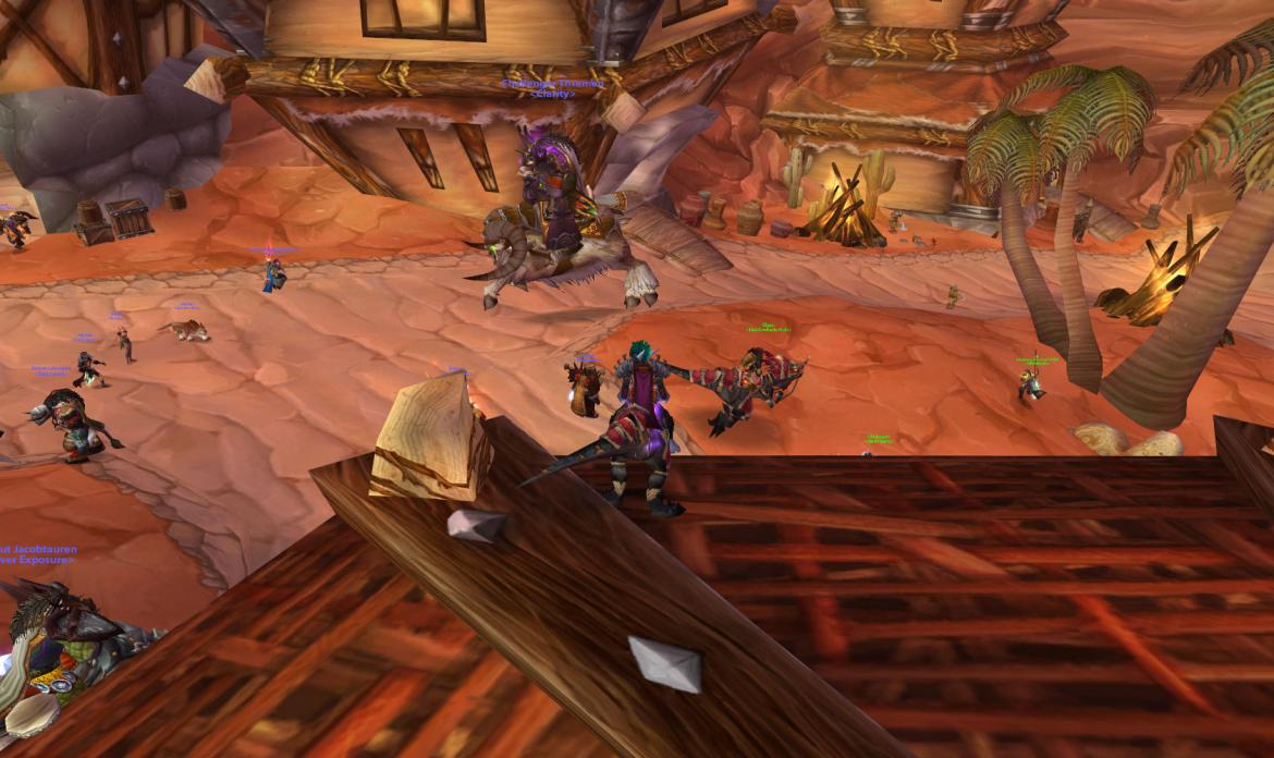 On the roof of the Orgrimmar bank looking at a huge tauren on a Brewfest Ram