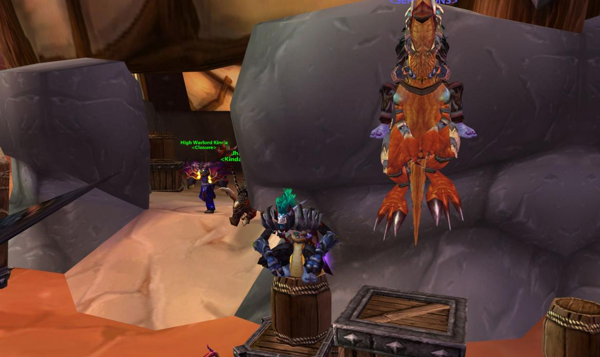 Troll wearing a Competitor's Tabard next to a jumping Troll on a raptor